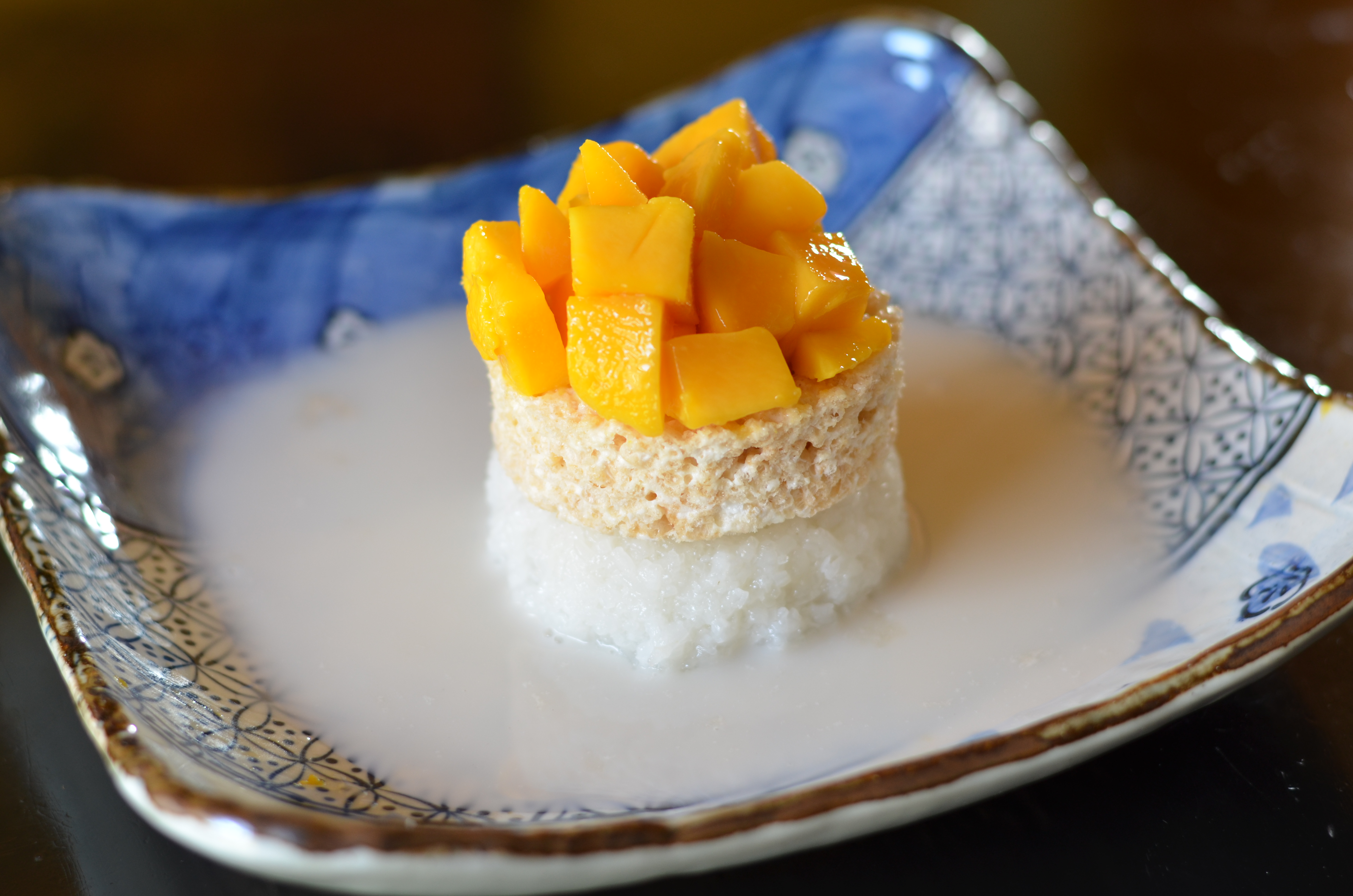 The Best Way To Eat This Is To Just Take Your Spoon And Cut Off A Part Of  The Side, Making Sure To Get All Four Parts: Rice, Crisped Rice, Mango,