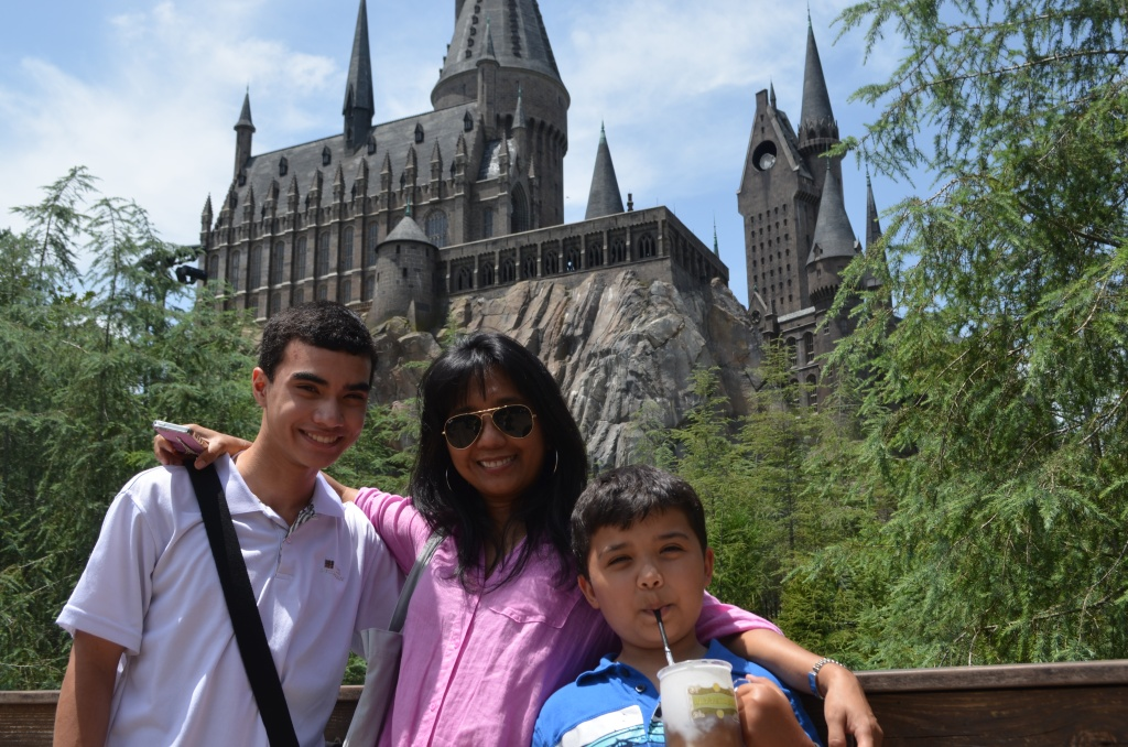 Here's my mom, brother, and me outside Hogwarts Castle! Notice the Butterbeer in my brother's hands. :)
